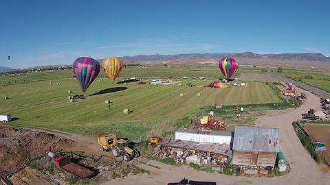 Aerial farm shed hot air balloon landing field HD 063 Footage