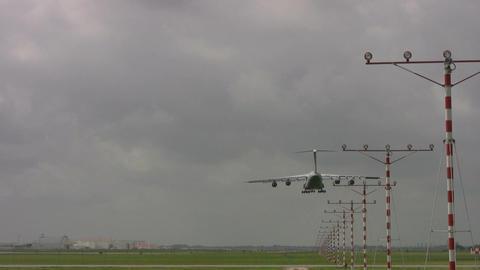 Aircraft C-5 landing going away Footage