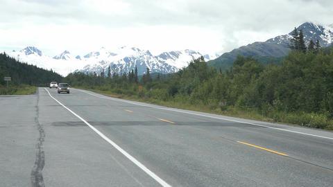 Autos passing view Alaska mountains P HD 8470 Footage