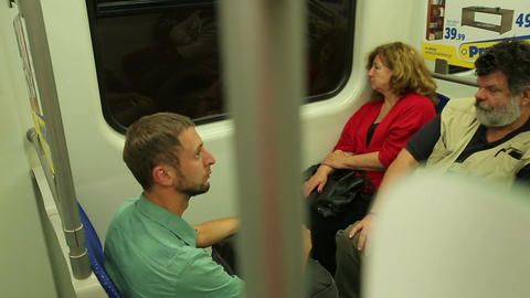 Exhausted people sitting in public transport, ordinary subway passengers, metro Footage