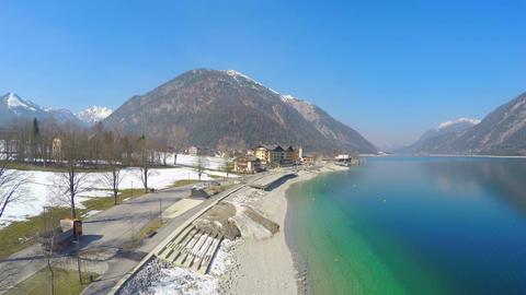 Cars driving, people walking along lakeside, Alpine mountain resort, off-season Footage