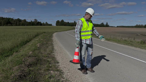 Road construction worker with traffic cone ask where put first cone Footage