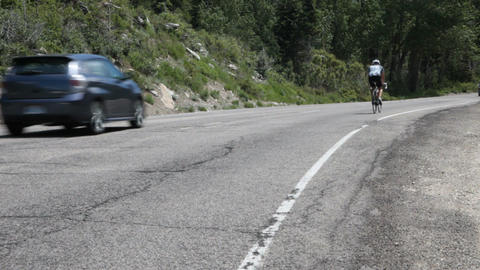 Bike on mountain road P HD 0674 Footage
