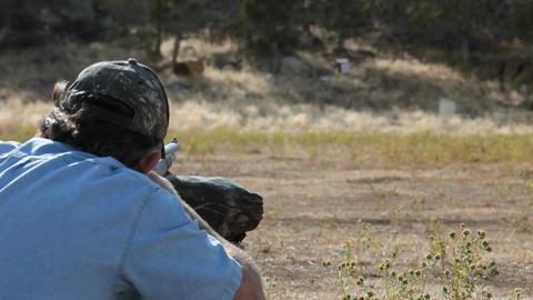 Black powder rifle over shoulder P HD 2264 Footage