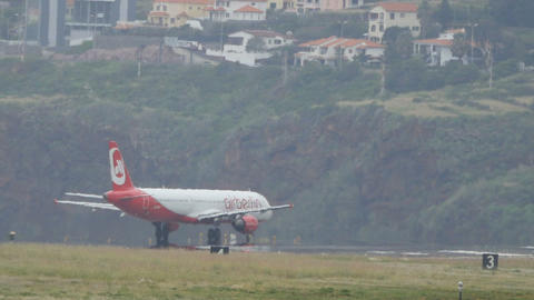 Airbus A321 by Air Berlin on Madeira Airport Runway with Beautiful Scenery Live Action