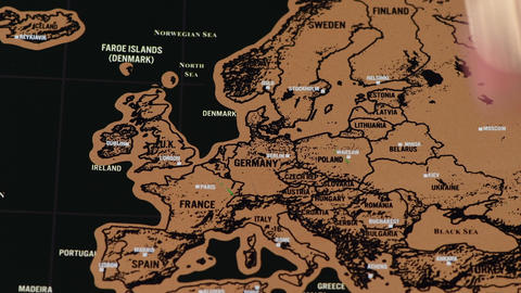 One dollar coin on black scratch travel map of Europe, EU Live Action