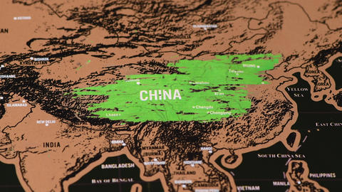one dollar coin scratch on black scratch travel map of China, Asia Live Action