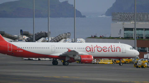 Civil Airplane Parks at Funchal Airport. Airbus A 321 by AirBerlin 4K Ultra HD Live Action