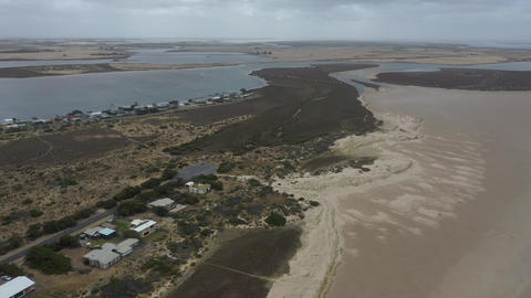 Drone aerial footage of the white sandy beach of The Coorong in South Australia Live Action