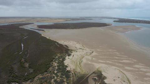 Drone aerial footage of the white sandy beach at The Coorong in South Australia Live Action