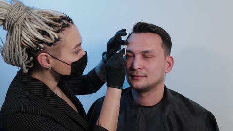 Eyebrow man treats man s eyebrows with special solutions Live Action