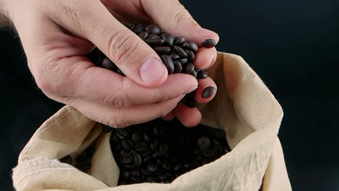 man hand holding coffee beans in canvas sack and some falling down, shot slow motion, agriculture ライブ動画