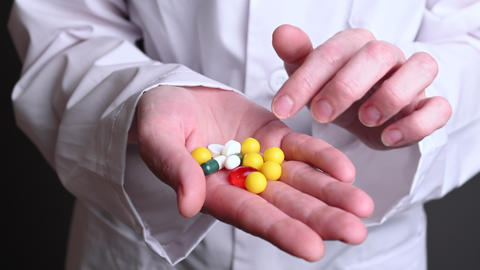 different pills in hand. treatment of people from viruses and diseases Live Action