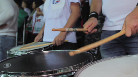 sports fan plays drums supporting favorite hockey team Live Action
