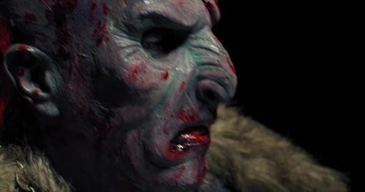 Close up of a scary orc with bloody face, profile shot, realistic fantasy, 4k Live Action