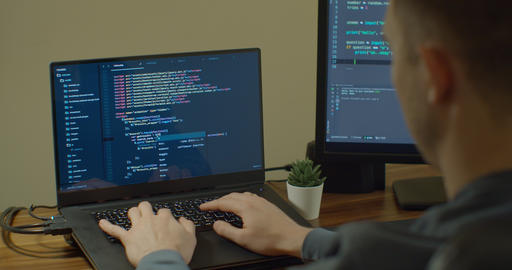 Closeup coding on screen, Man hands coding html and programming on screen Live Action