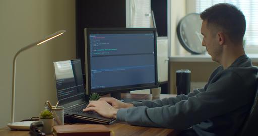 Man coding html and programming on screen Monitors, development web, developer Live Action
