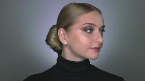 Natural Beauty. Beautiful woman with makeup posing at the camera Live Action