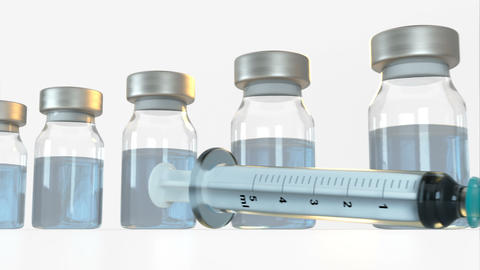 Syringe and row of vials with vaccine 3D render animation Animation