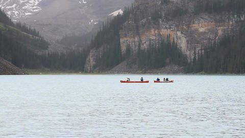 Canoes cross Lake Louise P HD 1179 Footage
