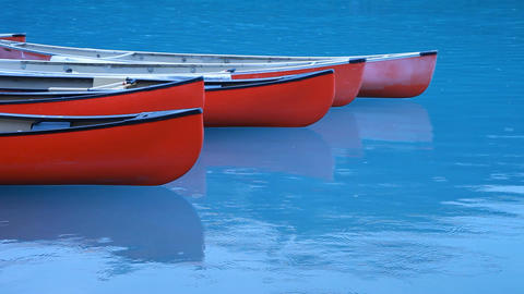 Canoes floating blue lake P HD 7482 Footage