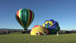 Colorful hot air balloons prepare for takeoff launch 4K 037 Footage