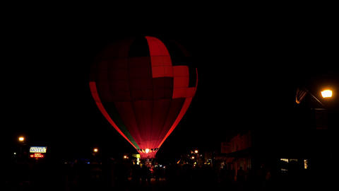 Community festival night hot air balloon glow 4K 196 Live Action