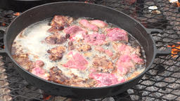 Cooking meat over camp fire cast iron pans 4K 016 Footage
