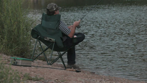 Don fishing sitting close P HD 1770 Footage