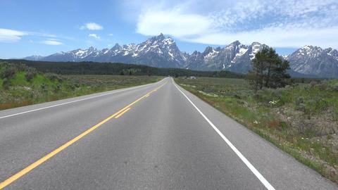 Driving POV towards Grand Teton NP Mountains 4K Archivo