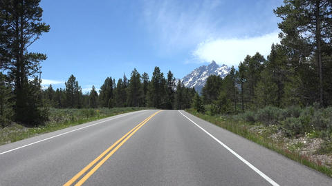 Driving POV beautiful Grand Teton Mountain range forest 4K Footage