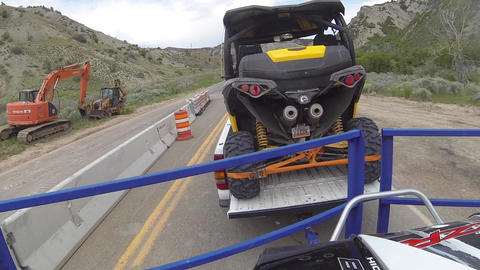 Driving tow off road vehicles through construction area POV HD 350 Footage