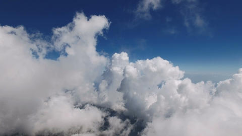 Flying Through Soft Fluffy Clouds on High Altitude Footage