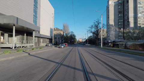 empty road during quarantine, street with tram tracks, camera movement forward Live Action