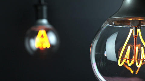 retro vintage light bulb with led technology built-in with change focus on vintage light bulb in Live Action