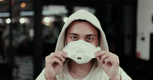 A man puts on a mask from a virus. Respirator with a degree of protection of 3M Live Action
