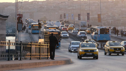 Traffic on Unkapani Bridge at sunset in Istanbul. Modern city life and transportation concept Live Action