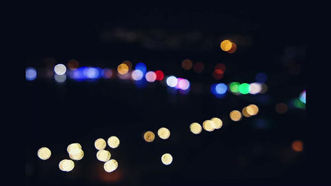 Abstract blurry bokeh lights on the coast at night, background and outdoor Live Action