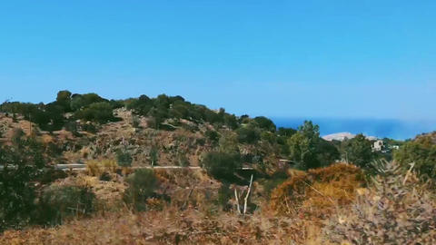Road in the mountains along the seaside in hot summer, nature and travel Live Action