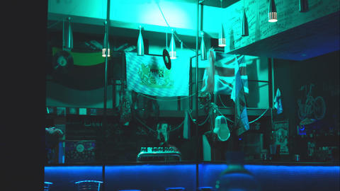 The interior of a small bar in dim lighting Live Action