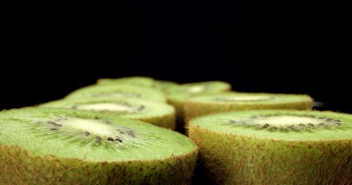 Juicy fresh kiwi fruit cut in half super macro close up shoot fly over 4k shoot on dark background Live Action