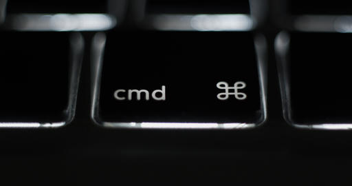 Pressing command cmd key on laptop computer keyboard Live Action
