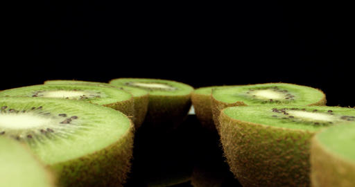 Juicy fresh kiwi fruit HQ cut in half super macro close up shoot fly over shoot on dark background Live Action