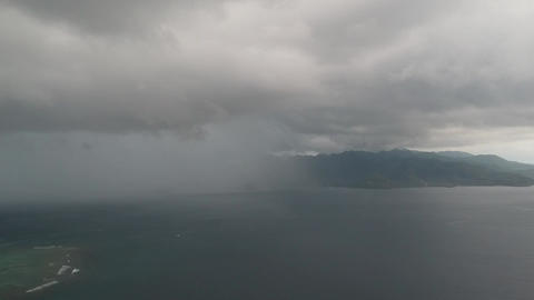 rain on a half frame in cloudy weather taken from a drone Live Action