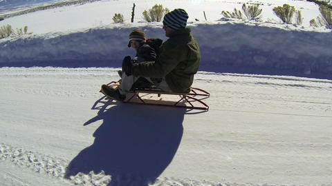 Father son winter recreation sled riding rural road HD 004 Footage