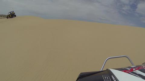 Friends riding ATV POV sand dunes Utah desert fast HD Footage
