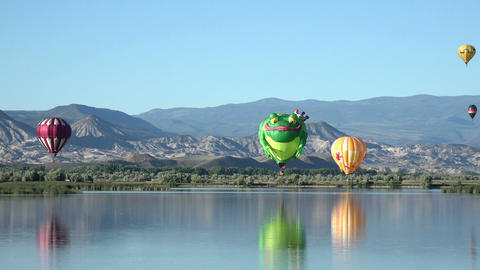 Frog Prince hot air balloon over lake 4K 053 Footage