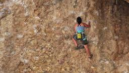 Girl climbing Maple Canyon rock face HD 2672 Footage