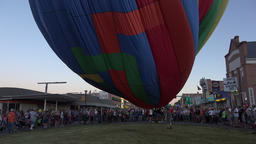 Hot Air Balloon sunset fill on main street downtown 4K 177 Footage