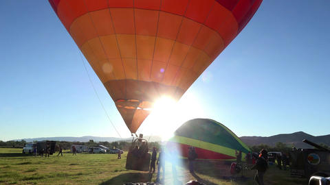 Hot air balloon takeoff sun flare sunrise 4K 027 Footage